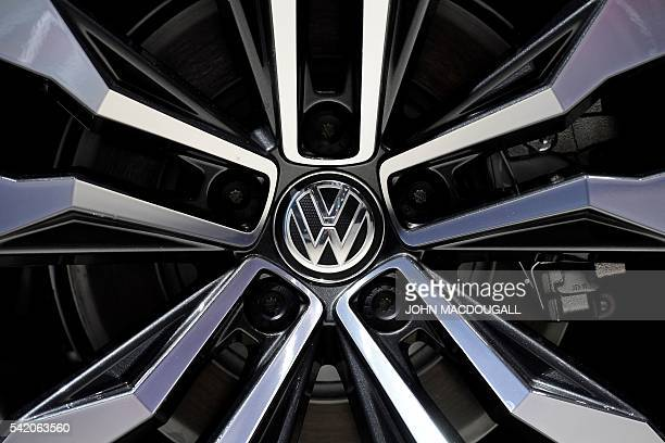 A Volkswagen logo on the wheel of a Tiguan is pictured during German carmaker Volkswagen shareholders' annual general meeting on June 22 2016 in...