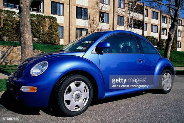 Volkswagen New Beetle Parked on Street