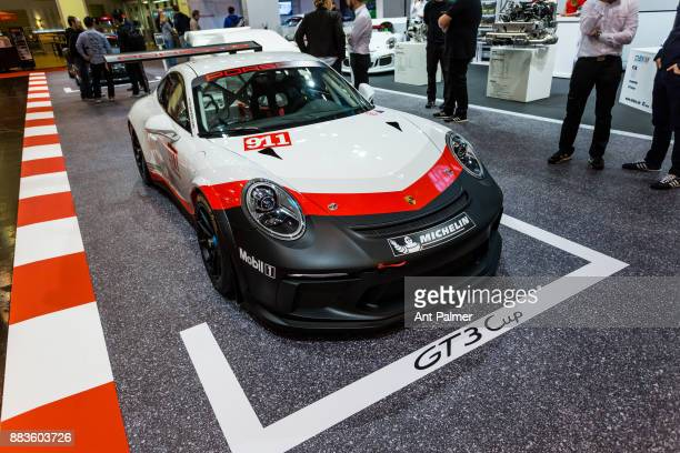 Volkswagen owned Porsche display their latest motorsport vehicles at the Essen Motor Show on December 1 2017 in Essen Germany The Essen Motor Show is...