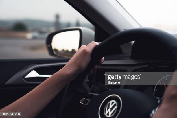 volkswagen polo, steering wheel with logotype - volkswagen stock pictures, royalty-free photos & images