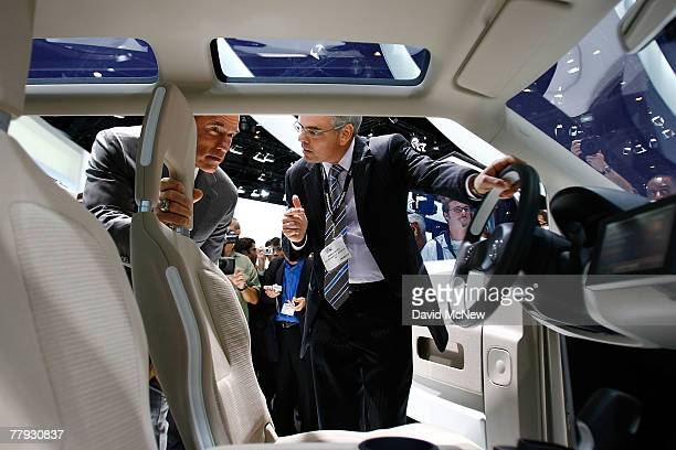 Volkswagen President and CEO Stefan Jacoby shows California Gov Arnold Schwarzenegger a fuelcell powered concept car called space up Blue during the...