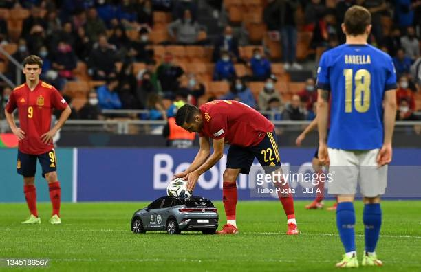 Volkswagen Remote Control Mini Car is seen carrying the official Adidas Uniforia Match Ball as Pablo Sarabia of Spain collects it prior to the UEFA...