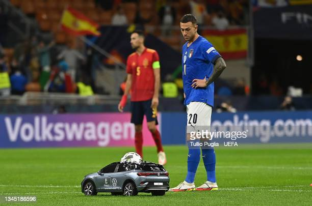 Volkswagen Remote Control Mini Car is seen carrying the official Adidas Uniforia Match Ball as Federico Bernardeschi of Italy looks on prior to the...