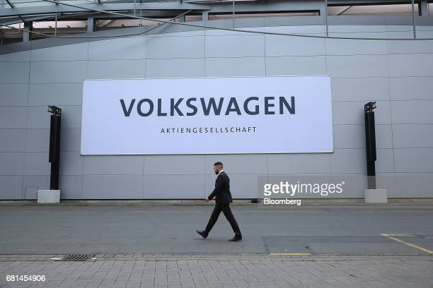 A Volkswagen sign sits on the exterior of the Hannover Messe during Volkswagen AG's annual shareholders' meeting in Hannover Germany on Wednesday May...