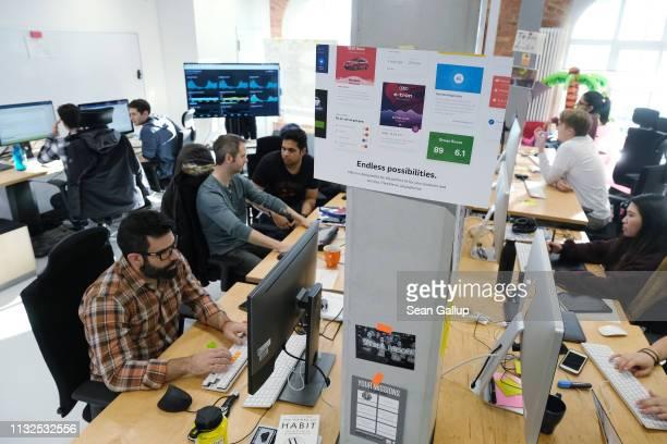 Volkswagen software developers work at the Volkswagen Digital Lab on February 27, 2019 in Berlin, Germany. Volkswagen is seeking to advance its...