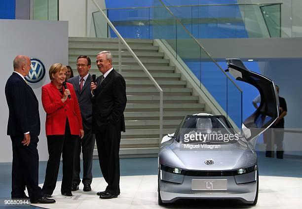 Volkswagen supervisory board chairman Ferdinand Piech German Chancellor Angela Merkel Matthias Wissmann president of the VDA federation of the German...