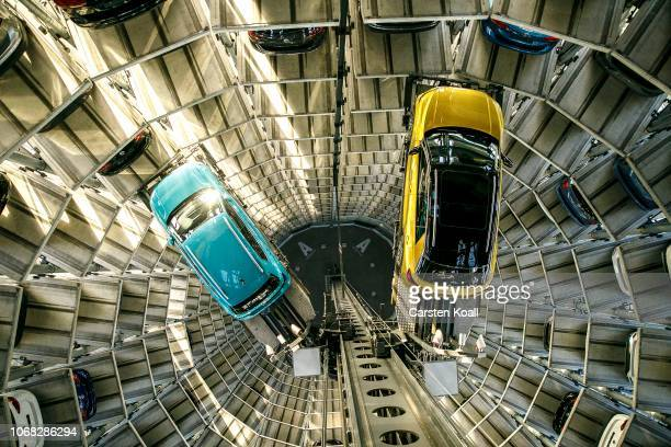 Volkswagen TCross and a Volkswagen tRoc are presented in one of the twin car towers at the Volkswagen Autostadt visitors center on December 4 2018 in...
