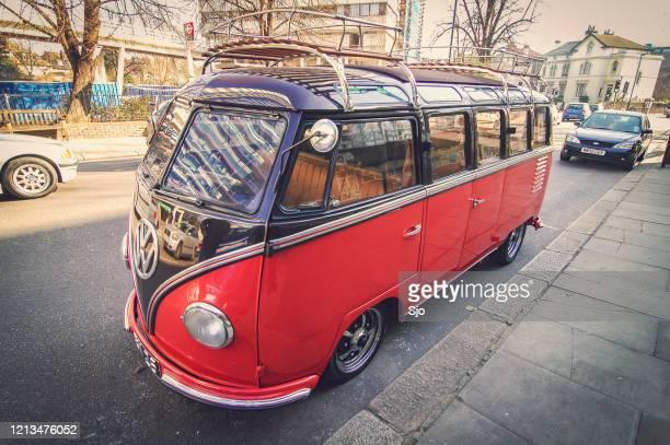 "volkswagen type 2 transporter kombi or microbus parked on the street in london, uk - ""sjoerd van der wal"" or ""sjo"" stock pictures, royalty-free photos & images"
