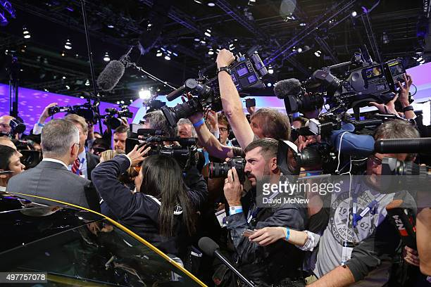 Volkswagen US CEO Michael Horn is surrounded by cameras and reporters after presenting at the 2015 Los Angeles Auto Show on November 18 2015 in Los...