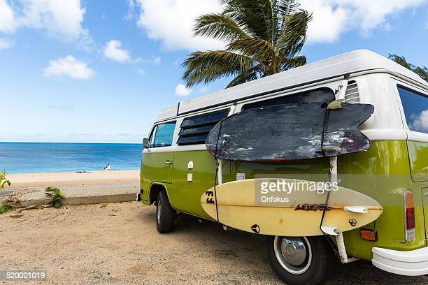 volkswagen westfalia camper van on tropical beach and surf boards - volkswagen stock pictures, royalty-free photos & images