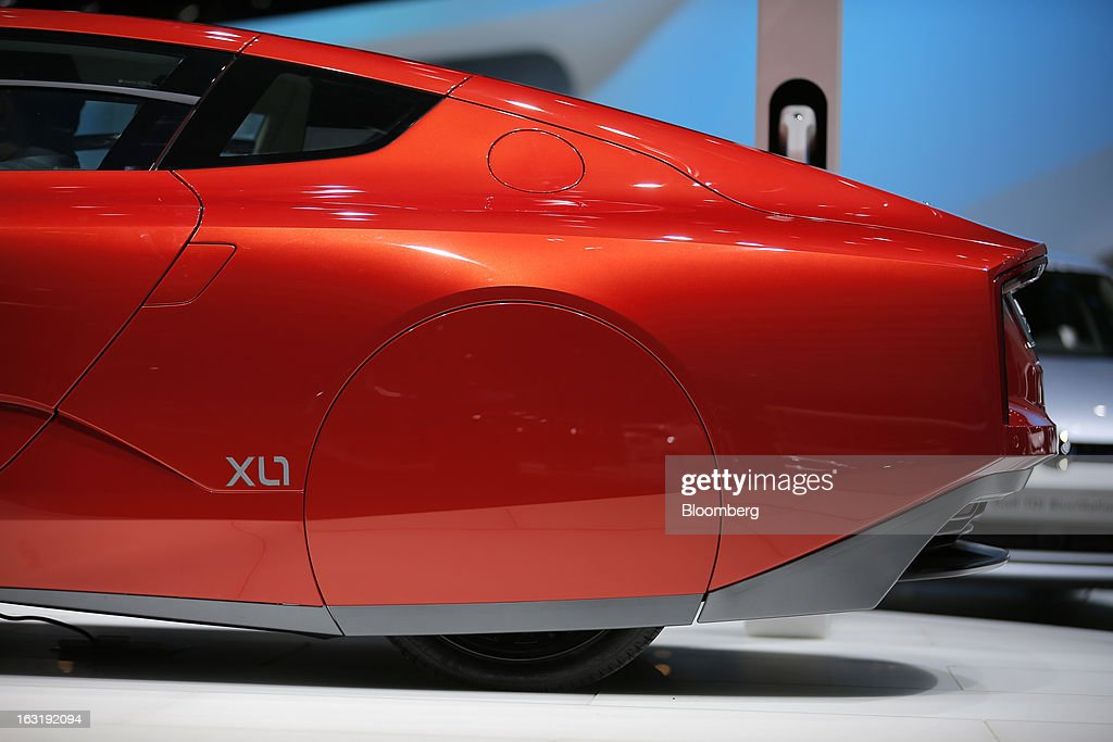 A Volkswagen XL1 automobile, produced by Volkswagen AG (VW), is seen on display on the second day of the 83rd Geneva International Motor Show in Geneva, Switzerland, on Wednesday, March 6, 2013. This year's show opens to the public on Mar. 7, and is set to feature more than 100 product premiers from the world's automobile manufacturers. Photographer: Valentin Flauraud/Bloomberg via Getty Images