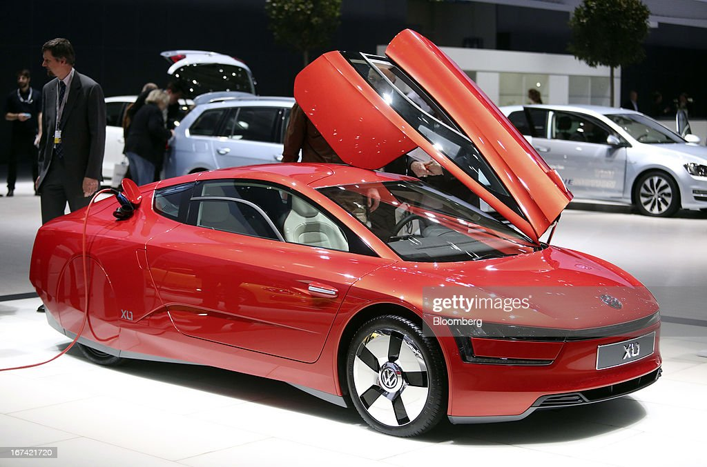 A Volkswagen XL1 automobile stands on display at the Volkswagen AG annual general meeting (AGM) in Hanover, Germany, on Thursday, April 25, 2013. Volkswagen AG, Europe's biggest automaker, aims to offset plunging European demand this year by rolling out 60 new and updated models, including luxury cruisers like the Bentley Flying Spur. Photographer: Chris Ratcliffe/Bloomberg via Getty Images
