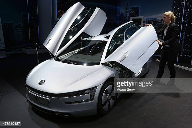 Volkswagen XL1 plug-in diesel-electric hybrid automobile sits on display at the Electric Mobility Week , a public Volkswagen event at the former...