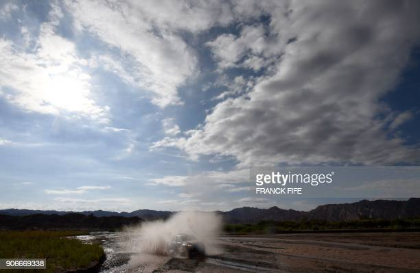 Volkswager South African driver Hennie De Klerk Hennie and codriver Gerhardt Schutt compete during the 2018 Dakar Rally's Stage 12 between Chilecito...