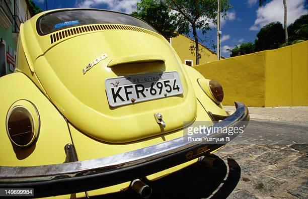 Volkswagon beetle parked on street.