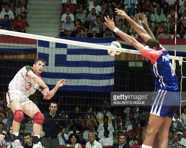 A volley from Portuguese Fernando Silva is blocked by the Cuban player Pavel Pimienta during the second match between both teams played in Havana...