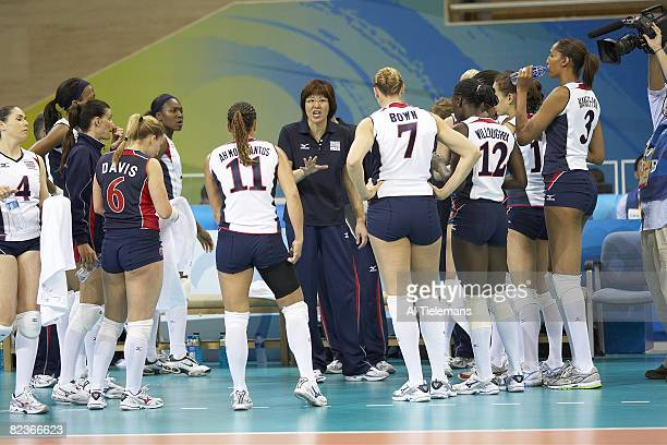 2008 Summer Olympics USA coach Ping Lang talks to team during Women's Volleyball Preliminary Round vs Cuba at Capital Indoor Stadium Beijing China...