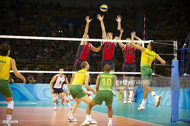 2008 Summer Olympics USA Lloy Ball Ryan Millar and Riley Salmon in action vs Brazil Murilo Endres during Men's Final at Capital Gymnasium Beijing...