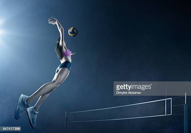 volleyball: beautiful female player in action - volleyball mannschaftssport stock-fotos und bilder