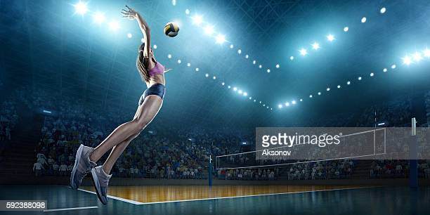 volleyball: female player in action - equipamento esportivo - fotografias e filmes do acervo