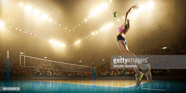 volleyball: female player in action - volleyball mannschaftssport stock-fotos und bilder