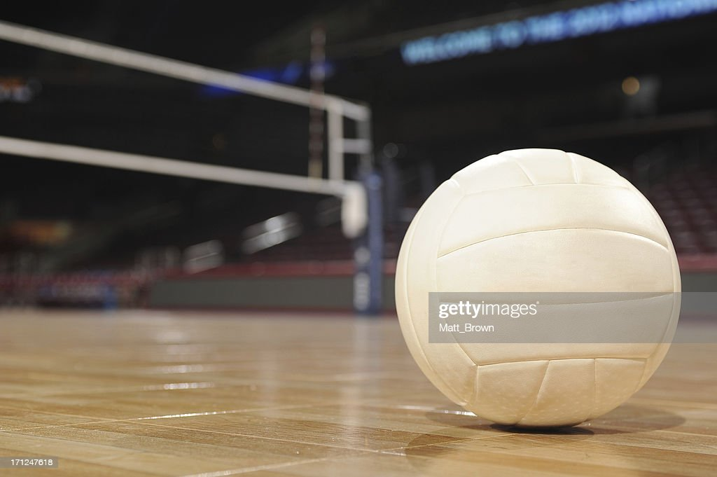 Volleyball in an empty gym : Stock Photo