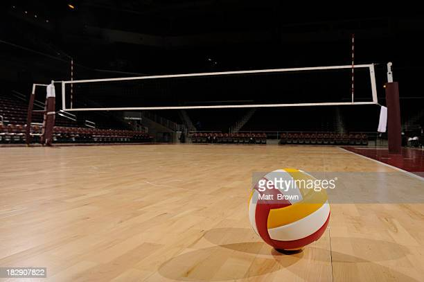 volleyball in an empty gym - sports court stock pictures, royalty-free photos & images