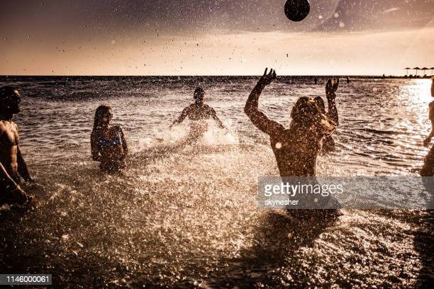 Volleyball in the sea at sunset!
