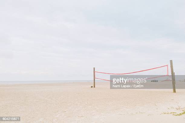 Volleyball Net On Beach Against Sky