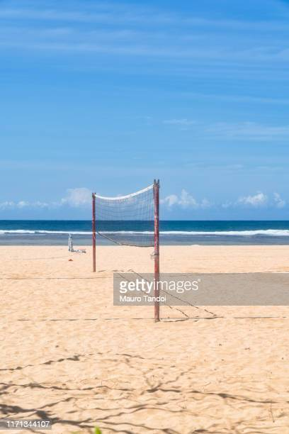 volleyball net on nusa dua beach, bali island - mauro tandoi stock photos and pictures