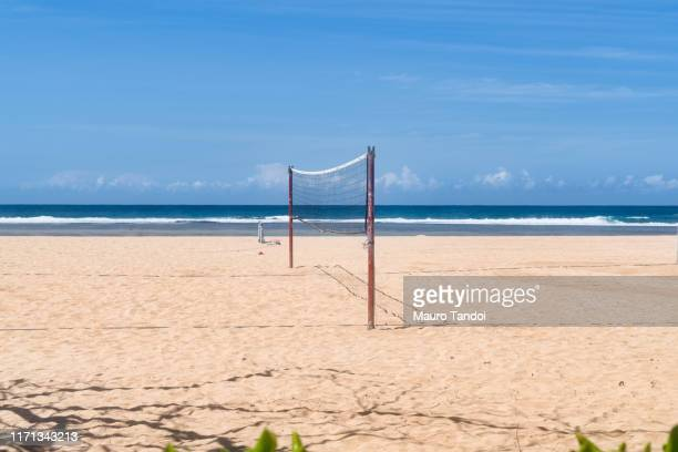 volleyball net on nusa dua beach - mauro tandoi stock photos and pictures
