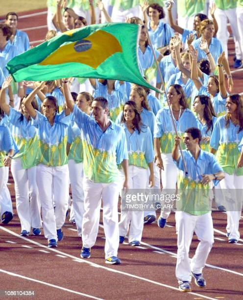 Volleyball player Mauricio Lima leads the Brazilian delegation waving to the public during the opening ceremony of the XIV Pan American Games at the...