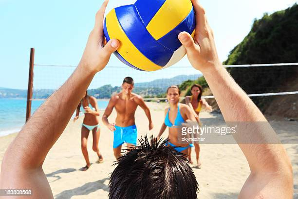 Volleyball team is running to the ball.