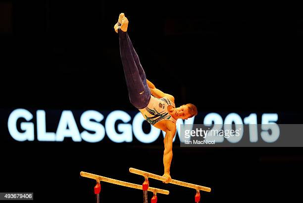 Volodymyr Okachev of Ukraine goes through his routine on the parallel bars during the 2015 World Artistic Gymnastics Championships Training Session...
