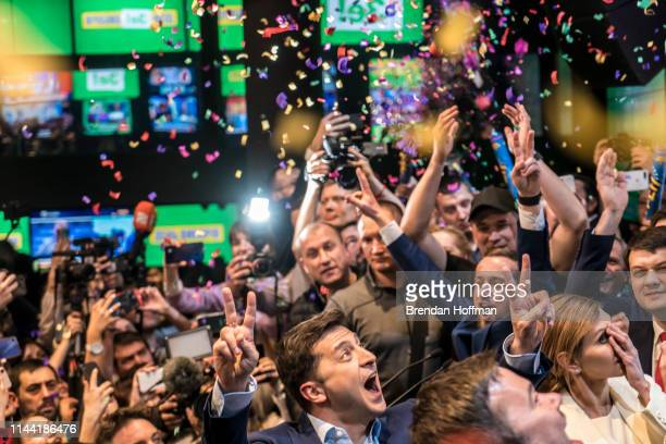 Volodymyr Zelenskiy celebrates his apparent victory in Ukraine's presidential race at his electionday headquarters after polls closed on April 21...
