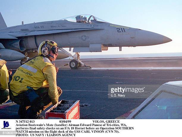 Volos, Greece Aviation Boatswain's Mate Airman Edward Pauese Of Tri-Cities, Wa, Performs Final Safety Checks On An F/A 18 Hornet Before An Operation...