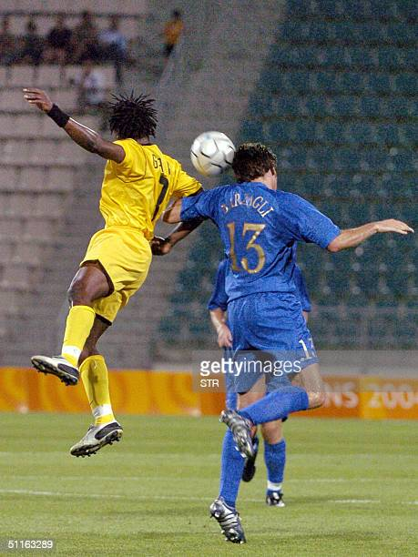 Ghana's Abubakari Yahuza jumps for the ball against Italy's Andrea Barzagli during their Group B Olympic match at the Panthessaliko Stadium in Volos...