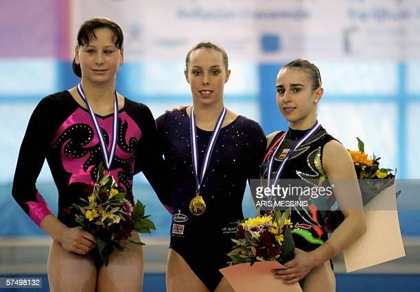 Gold medalist Elizabeth Tweddle of Great Britain silver medalist Jana Sikulova of Czech Republic and bronze medalist Lenika De Simone of Spain pose...