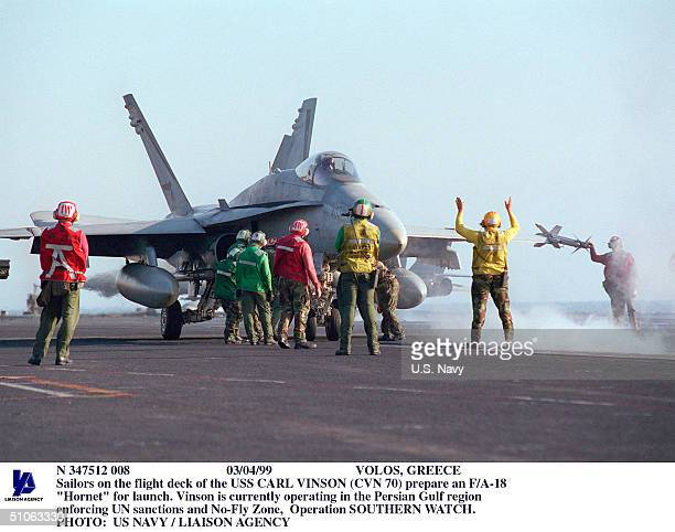 """Volos, Greece Sailors On The Flight Deck Of The USS Carl Vinson Prepare An F/A-18 """"Hornet"""" For Launch. Vinson Is Currently Operating In The Persian..."""