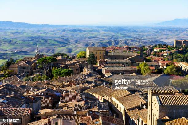 volterra rooftops and countryside, italy - volterra stock photos and pictures