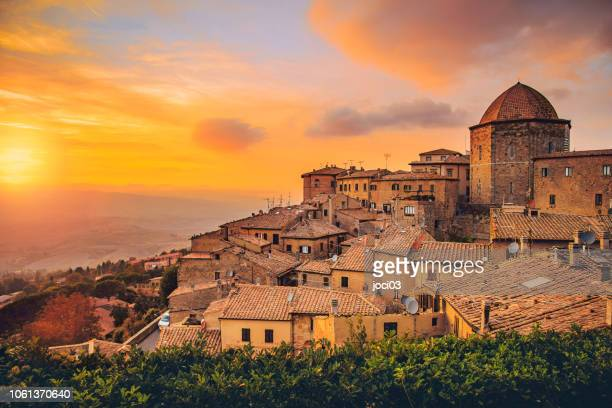 volterra, walled town southwest of florence, in italy. - ancient stock pictures, royalty-free photos & images