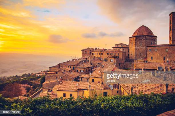 volterra, walled town southwest of florence, in italy. - tuscany stock pictures, royalty-free photos & images