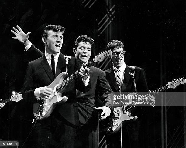 Volume 2 Page 100 Picture 23 1960's Cliff Richard and the Shadows on stage pictured lr Brian Locking Cliff Richard and Hank Marvin