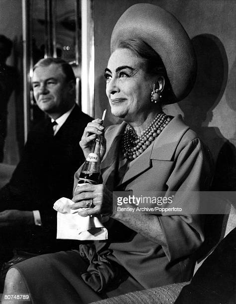 Volume 2 Page 103 Picture 10 18th April 1966 London England US film actress Joan Crawford drinks Pepsi through a straw from a bottle at the Savoy...