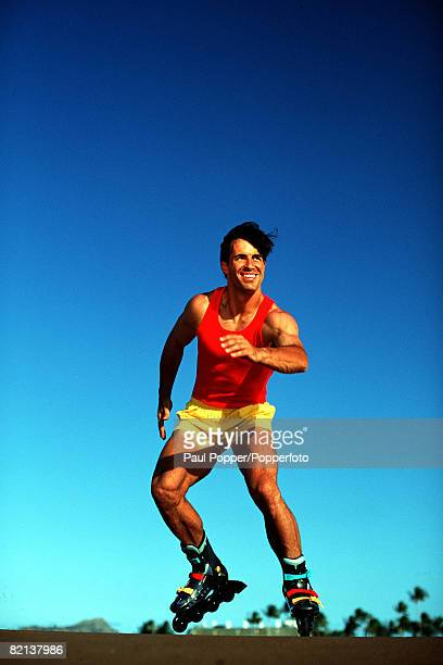 Volume 2 Page 11 Picture 1 Sport A man wearing a red vest and yellow shorts roller blading