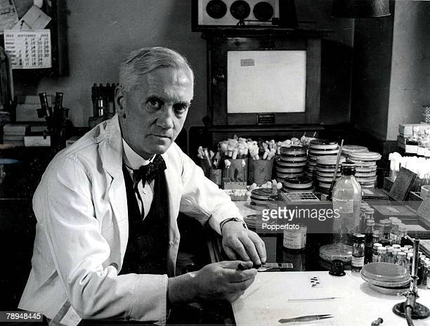 Volume 2 Page 114 Picture 4 Sir Alexander Fleming sits next to a collection of testtubes and dishes in his laboratory Discovered penicillin