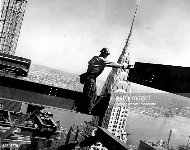 Volume 2 Page 119 Picture 4 A steel worker balances on a girder high up above New York city USA 1962
