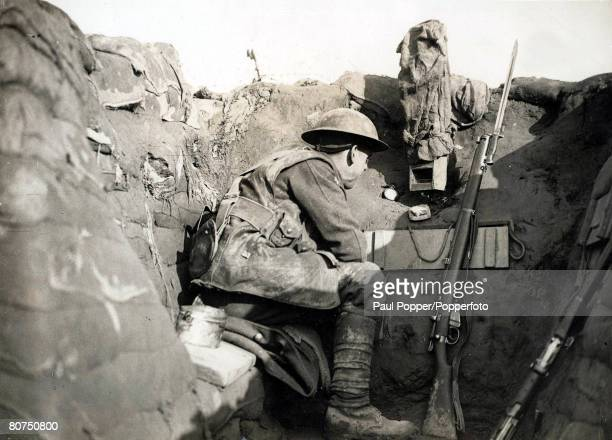 Volume 2 Page 124 Picture 2 World War One 1914 1918 Western Front France A British Soldier looking out over their trenches towards enemy positions...