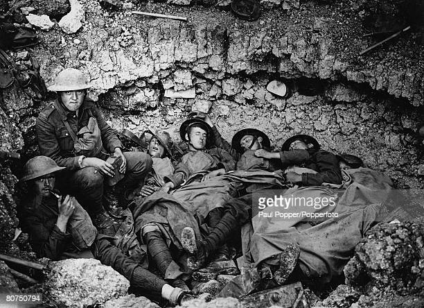 Volume 2 Page 125 Picture 8 World War One Western Front Soldiers of the Duke of Wellington regiment resting in a shell hole after an advance