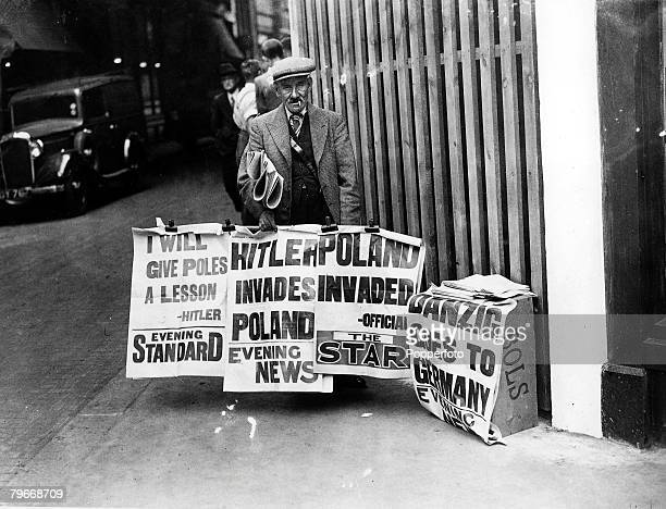 Volume 2 Page 126 Picture 2 World War Two London England 1st September A solemn looking newspaper vendor displays posters of the gloomy headlines...